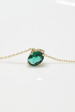 Emerald pendant necklace, birthstone of May